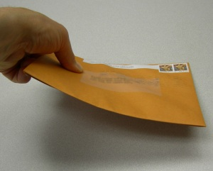 Ridged letter sized mail = USPS parcel.  $0.78 postage premium.  Oops.